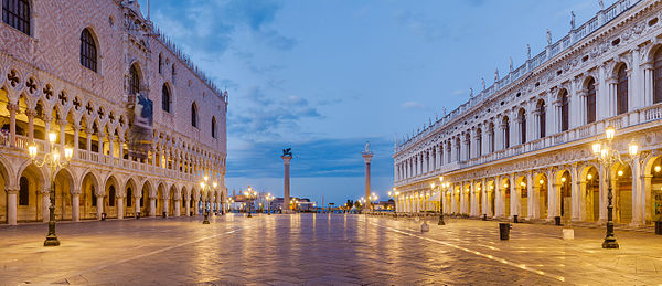 View of Piazzetta San Marco toward Grand Canal of Venice, at dawn, with Doges' Palace on the left and Biblioteca Marciana on the right. The two columns are, from left to right, Saint Mark's, protector of the city, and Saint Theodore's.
