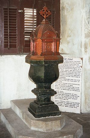 Charnockite, St. Thomas Mount - Baptismal Font at St. Mary's Church at Fort St. George in Chennai with a plaque behind it that corroborates the history