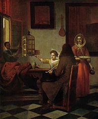 Company with a black pageboy and a woman feeding a parrot