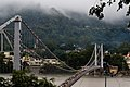 Pilgrims crossing the Sivananda bridge also known as Ram jhula, Muni ki Reti, Rishikesh.jpg