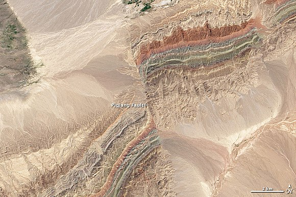 Satellite image of the Piqiang Fault, a northwest trending left-lateral strike-slip fault in the Taklamakan Desert south of the Tien Shan Mountains, China (40.3degN, 77.7degE) Piqiang Fault, China detail.jpg