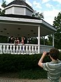 Preprom Pictures in Local Park with family members photographing couples.jpg
