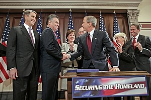 Peter T. King - President George W. Bush shakes hands with Congressman Peter King, chairman of the United States House Committee on Homeland Security, after signing H.R. 4954, the SAFE Port Act