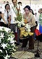 President Gloria Macapagal-Arroyo offers a bunch of flowers to the tomb of her late father.jpg