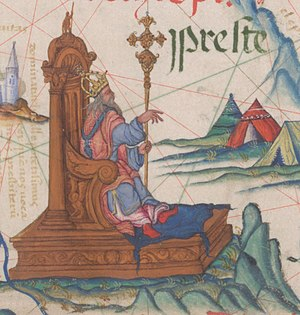 "Prester John - ""Preste"" as the Emperor of Ethiopia, enthroned on a map of East Africa in an atlas prepared by the Portuguese for Queen Mary, 1558. (British Library)"