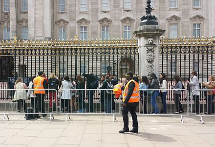 The queue outside Buckingham Palace to view the ornate golden easel holding the official announcement of Charlotte's birth Queue to view the official announcement of the birth of Princess Charlotte.jpg