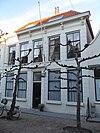 foto van Huis met gepleisterde lijstgevel