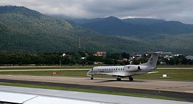 RTN Embraer ERJ 135LR beneath Wat Doi Suthep.jpg