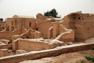 Qasr al-Banat - Reconstruction with newly fired bricks. Part of original wall in center. View from the northwest.