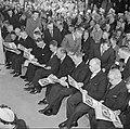 Rijen mannen in feestkleding, zittend in zaal, Bestanddeelnr 255-8513.jpg