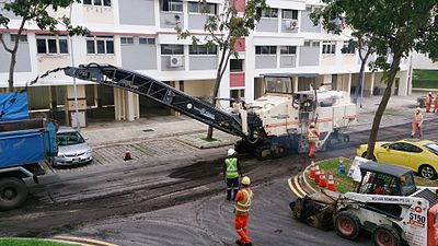 asphalt road being milled in preparation for repaving