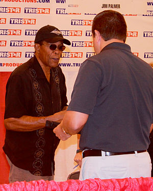Rod Carew - Carew (left) talks to a fan in May 2014.