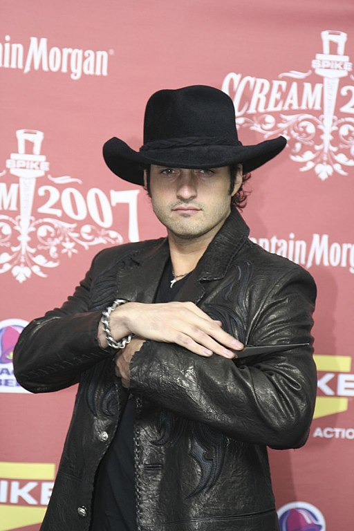 e9c3e1d8 By pinguino k from North Hollywood, USA (Robert Rodriguez) [CC BY 2.0], via  Wikimedia Commons. Plain, Brown Cowboy Hat