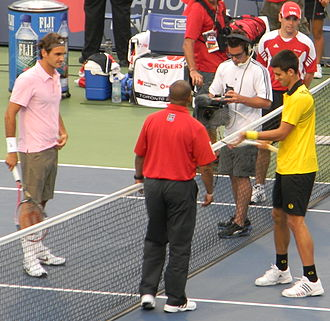 Djokovic–Federer rivalry - Federer and Djokovic at the Toronto Masters in 2010, moments before their longest Masters 1000 encounter. Federer went on to win in three sets.