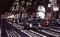 Roosevelt-avenue-queens-nyc cars driving-under-elevated-railway-line 1980s.jpg