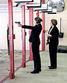 Rosario Dawson preparing to fire a M11 pistol at the firing range at Andrews Air Force Base, Md..jpg