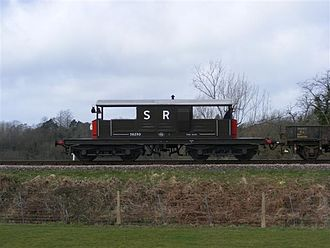 "Brake van - Preserved SR ""Queen Mary"" bogie brake van - most British brake vans had just four wheels and a rigid wheelbase. This one has all three side lamps visible."