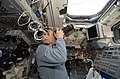 STS-125 Pilot Johnson Takes Photos on the Aft Flight Deck (28075338472).jpg