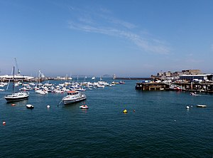 Saint Peter Port Harbour - View of the harbour from the shore, with New Jetty on the left and Castle Cornet to right