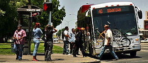 "San Joaquin Regional Transit District - A San Joaquin RTD ""Metro Express"" BRT bus boarding at Delta College in Stockton, California."
