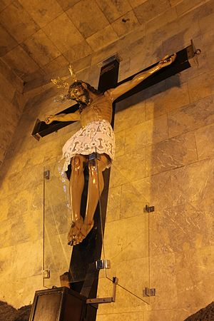 Santuario del Santo Cristo - The Santo Cristo image, its feet encased in glass, in the Calvario above the main altar.