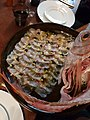 Sashimi plate presented with the fish carcass in the plate.jpg