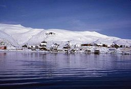 Scenic view from the water of a village on the island of Atka in the Aleutian islands.jpg
