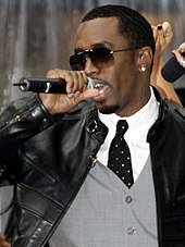A picture of a man wearing sunglasses singing