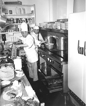 Flattop grill - Cooks at the Northern Lights Dining Room, Seattle, Washington, 1952. A flattop grill being used is located on the right.
