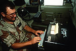 Senior Airman Matt Jones types messages on the AN-UYA-7 digital data system in the Airlift Control Center area during Exercise Shadow Hawk, a phase of Bright Star '87 DF-ST-89-00992.jpg