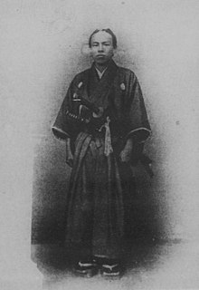 Il giovane Okuma nelle vesti tradizionali