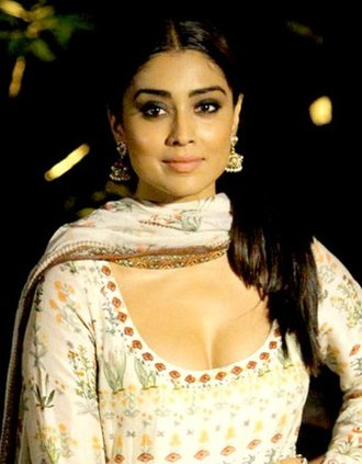 Dupatta - Indian actress Shriya Saran in a modern style of draping dupatta over the neck, while wearing ghagra choli or shalwar kameez