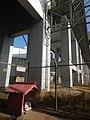 Small shrine on Tokaido Shinkansen under viaduct in Nagoya.jpg