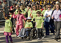 Special Olympic athletes and local volunteers participate in a parade, before starting the Special Olympic games, at Fort Gordon, Ga., Mar. 24 2010 100324-A-NF756-031.jpg