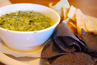 Dipping sauce - A spinach and artichoke dip with tortilla chips