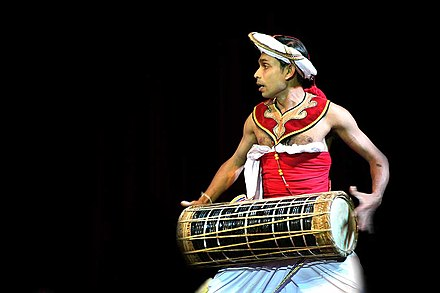 A Low Country drummer playing the traditional Yak Bera Sri Lanka traditional drum.jpg