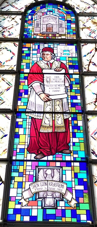 Stained glass depiction of Clement XI at the Catholic Cathedral in Prishtine, Kosovo Stained glass depiction of Pope Clement XI at the Cathedral of Saint Mother Teresa in Prishtina.jpg