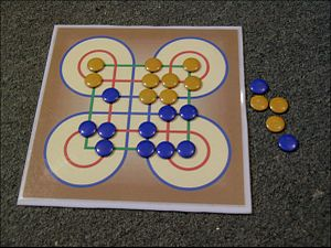 Surakarta (game) - Surakarta board game with two colored pebbles
