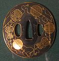 Sword guard (tsuba) with gold fans by Kusakari Kiyosada I.JPG