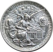 "In the center of a circular coin is a kneeling angel with her arm draped over the Alamo chapel. Under each of her wings is a circular portrait with the head and shoulders of a man; on the left the portrait is labelled Houston, on the right it is labelled Austin. Along the edges of the coin are the words ""The Texas Independence Centennial - Remember the Alamo""."