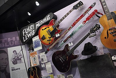 A display of historical blues instruments, posters, and sheet music. The Blues - Rock and Roll Hall of Fame (2014-12-30 11.46.33 by Sam Howzit).jpg