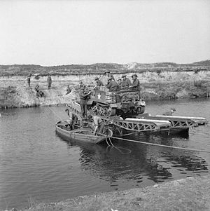 158th Infantry Brigade (United Kingdom) - A Universal Carrier of the 1st Battalion, East Lancashire Regiment being pulled across the Meuse-Escaut (Maas-Schelde) canal on a raft, near Lommel, 19 September 1944.