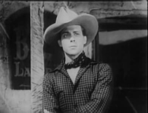 Dennis Moore (actor) - Dennis Moore in The Dawn Rider (1935)