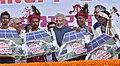 The Prime Minister, Shri Narendra Modi felicitates the beneficiaries of different schemes, at Naya Raipur, Chhattisgarh on November 01, 2016. The Chief Minister of Chhattisgarh, Dr. Raman Singh is also seen.jpg