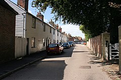 Sunny street with white clapperboard houses