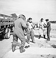 The crew of a Boeing Fortress Mk I of No. 90 Squadron RAF putting on electrically-heated flying suits at Polebrook, Northamptonshire, before taking off for a high-altitude bombing attack on the German battlecru CH3090.jpg