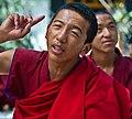 Tibetan buddhist monk during monastic debate making hand gesture at Sera Monastery, Lhasa, Tibet on 3 August 2008 (cropped).jpg