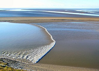 Tidal bore - A bore in Morecambe Bay, the United Kingdom.