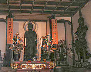 Twelve Heavenly Generals - Bhaisajyaguru Buddha (center) accompanied by one of the Twelve Heavenly Generals