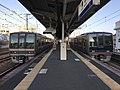 Trains of Sanyo Main Line and platform of Tarumi Station.jpg